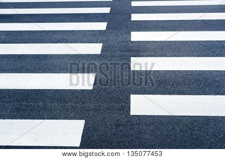 Closeup photo of the zebra pedestrian crossing.