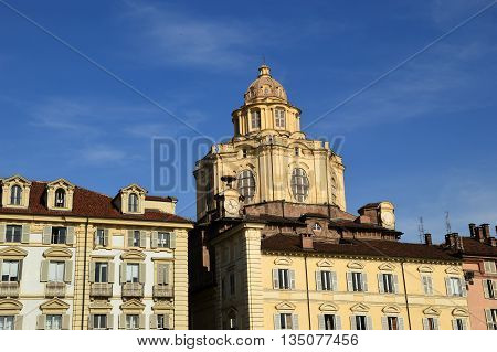 The buildings and the dome of the church of Piazza Castello in Turin in Piedmont - Italy