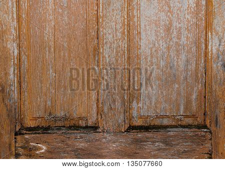 wooden house door was decay by moist and fungus