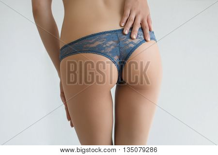 Sexy curves girl butt, without cellulite in white background
