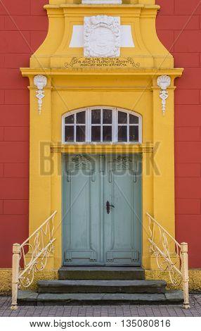 Green door of the Gymnasial Church in Meppen Germany