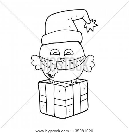 freehand drawn black and white cartoon cute christmas owl on wrapped present
