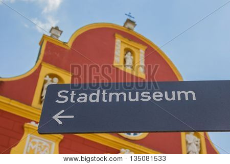 Tourist sign in front of the Gymnasial church in Meppen Germany
