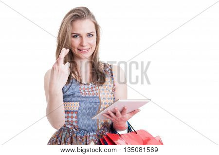 Portrait Of Young Hopeful Shopper Holding Fingers Crossed
