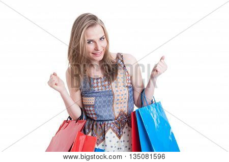 Portrait Of Cheerful Smiling Woman With Shopping Bags Looking Excited