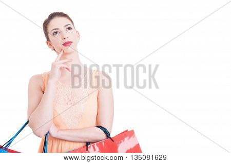 Attractive Lady Being Thoughtful Or Pensive Holding Shopping Bags