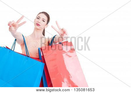 Woman Shopper Showing Victory Sign With Both Hands