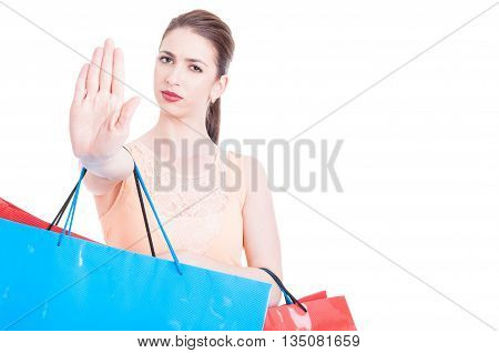 Woman Carrying Shopping Bags Making Stop Or Refusal Gesture