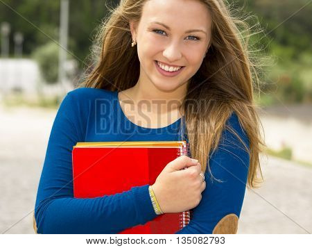 Beautiful and happy teenager student in the school
