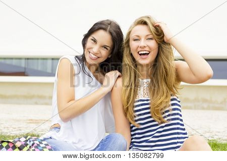 Happy teenage students in the school