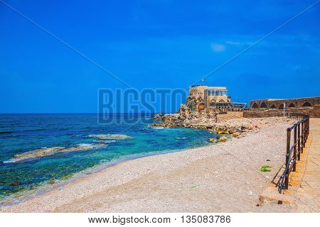 The restored castle on the sea spit. National park Caesarea on the Mediterranean. Israel