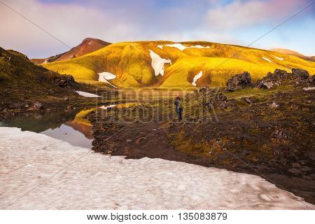 Magic sunrise in the Arctic. The golden light of dawn illuminates the mountains and glaciers national park Landmannalaugar, Iceland