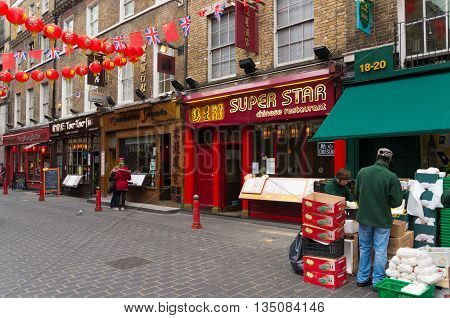 LONDON - OCTOBER 19 2015: Chinese restaurants and supermarkets in London chinatown. Chinatown is situated in the Soho district