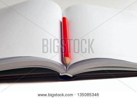 Close-up Of Open Book And Pen.