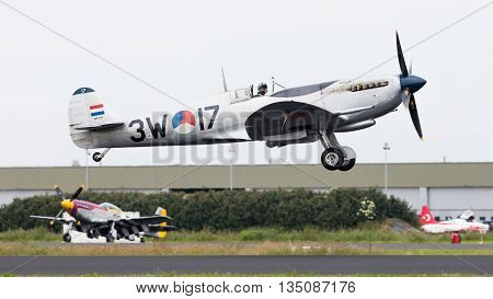 Leeuwarden, The Netherlands - June 10, 2016: A Vintage Spitfire Fighter Plane Makes A Low Flypast Fo