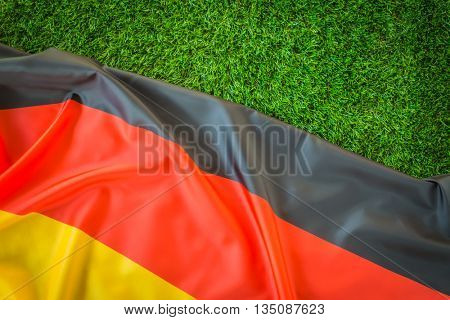 Flags of Germany on green grass