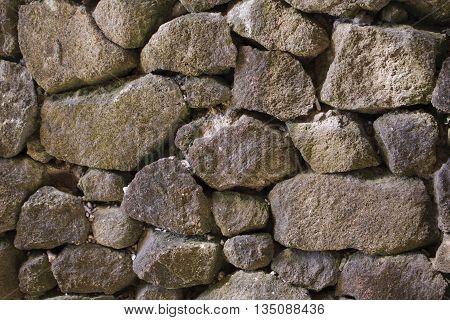 Stone wall background, irregular grey stone bricks design, garden wall made of big rocks