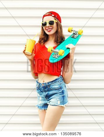 Fashion Pretty Cool Woman With Skateboard And Cup Of Fruit Juice
