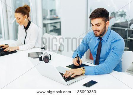 Young freelance designer works on a laptop
