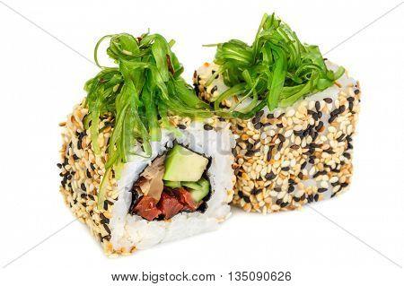 Uramaki maki sushi, two rolls isolated on white. Philadelphia cheese, eel, cucumber, dried tomatoes, avocado and sesame. Chuka seaweed on top.