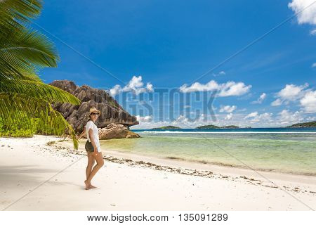Beautiful woman enjoying the beach in La Digue, Seychelles