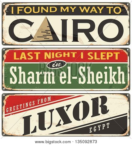 Egyptian cities and travel destinations. Retro metal plates set on old damaged background.