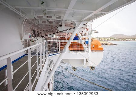 Lifeboat on side of a modern cruise liner