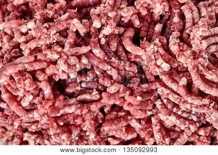 Close up of pinky raw ground beef.. Ground beef can be used to make hamburgers cutlet, chili con carne or other dishes.