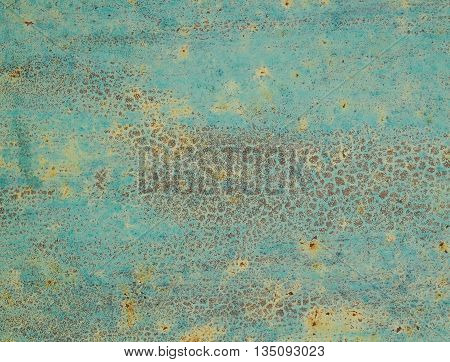 Old metal wall painted in light turquoise color use for background