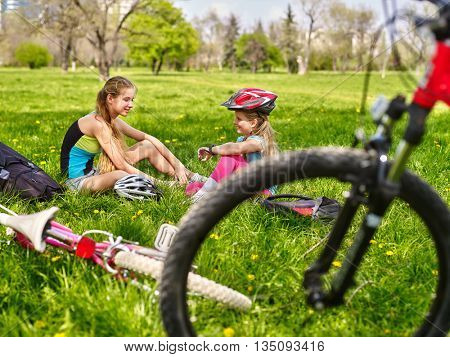 Bicycling girls. Girls children rides bicycle. Girls have rest from bicycling. Cycling is good for health. Cyclist looking look at each other and speaking.