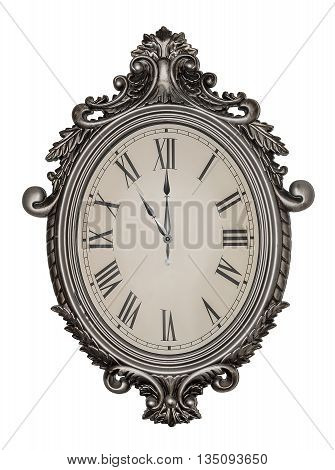 Eleven o'clock. Antique wall clock isolated on white background.