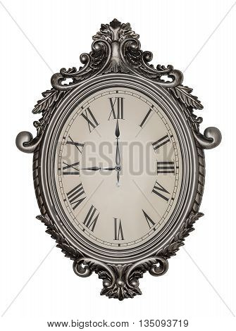 Nine o'clock. Antique wall clock isolated on white background.