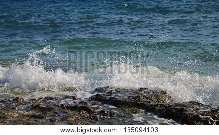 Stone beach and sea wave, ocean wave near beach