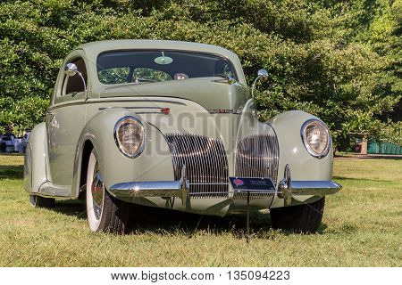 GROSSE POINTE SHORES MI/USA - JUNE 19 2016: A 1939 Lincoln Zephyr V12 car at the EyesOn Design car show, held at the Edsel and Eleanor Ford House, near Detroit, Michigan.