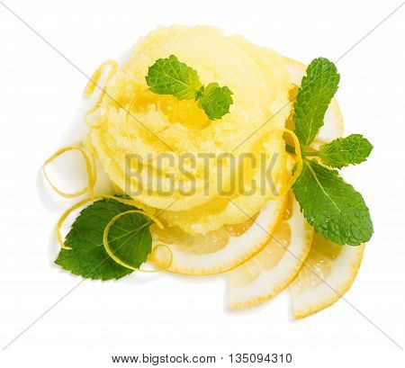 Top view of scoop of lemon ice cream decorated with zest and mint isolated on white background.