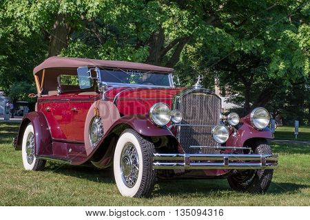 GROSSE POINTE SHORES MI/USA - JUNE 19 2016: A 1938 Pierce Arrow Sport Phaeton car at the EyesOn Design car show, held at the Edsel and Eleanor Ford House, near Detroit, Michigan.