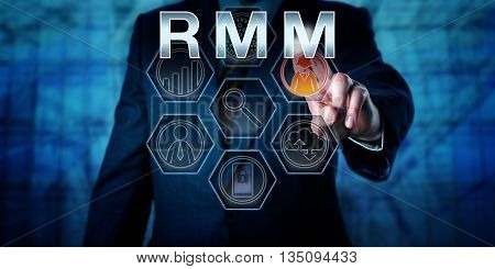 Torso of male business manager is pressing RMM on an interactive virtual control monitor. Business administration metaphor and information technology concept for Remote Monitoring and Management.