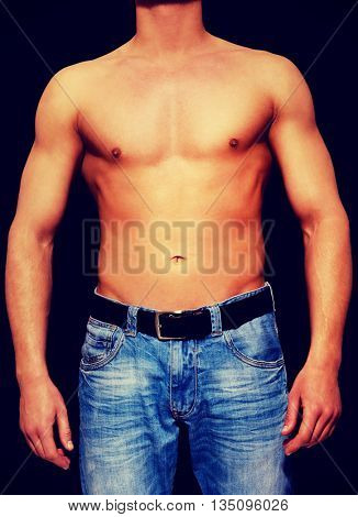 Young athletic man with muscular torso