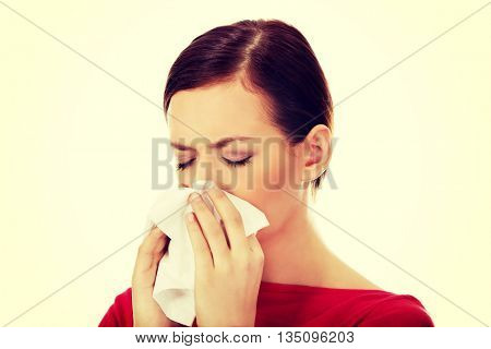 Young beautiful caucasian woman sneezing