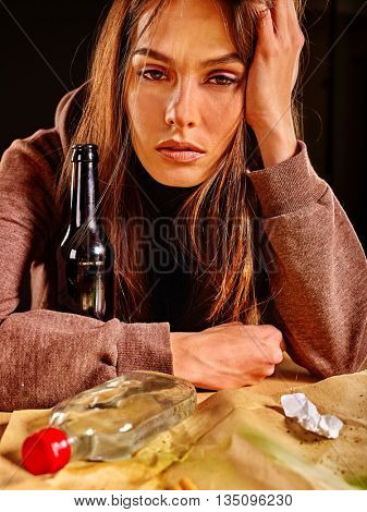 Girl in depression drinking bottle alcohol in solitude. Drinking habits. Girl is heavy alcohol drinkers.