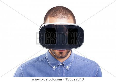 Man wearing virtual reality goggles, isolated on white background
