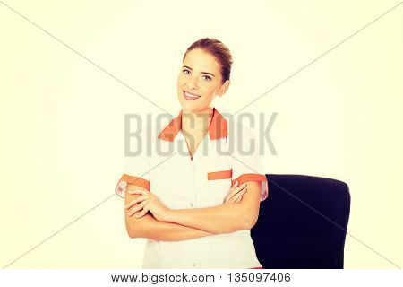 Young smile female doctor or nurse standing behind the desk