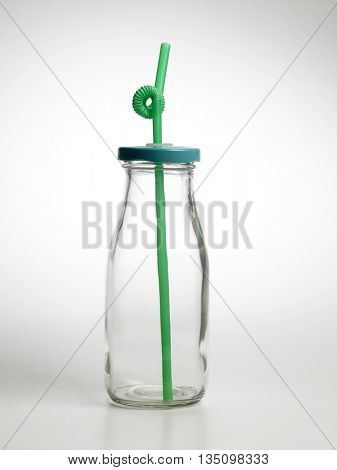 blank empty milk bottle with straw on the white background