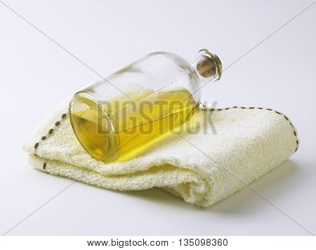 massage oil and towel on the white background