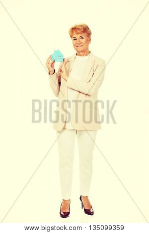 Smile elderly business woman holding blue paper house
