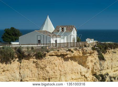 ARMACAO DE PERA PORTUGAL - MAY 18: A view of the chapel Capela Nossa Senhora da Rocha on the coast Algarve near city Armação de Pêra in the south of the country Portugal 2016