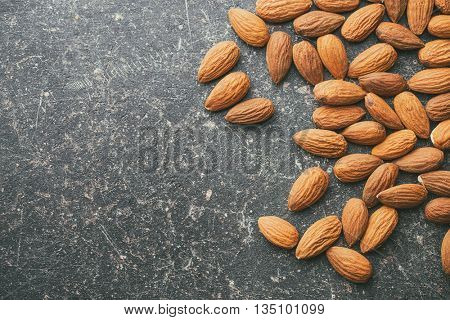 Dried almonds on old kitchen table.