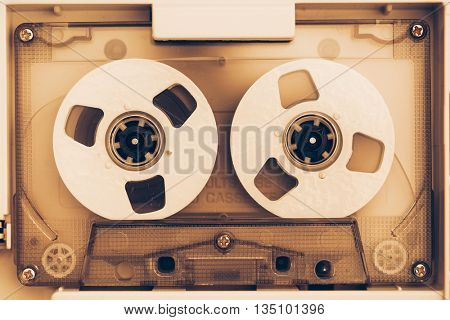 vintage audio tape compact cassette, sepia tone
