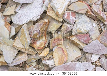 A big heap of sandstones, storage space of various natural sandstone