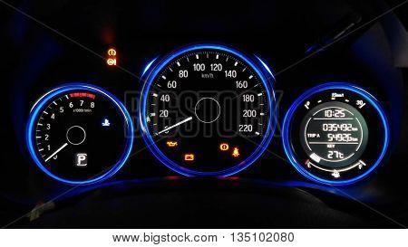 car illuminated dashboard closeup and Modern car instrument panel